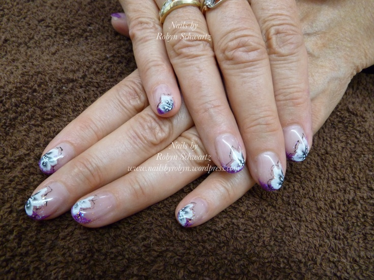 Gel nails, glitter and hand painted flowers.