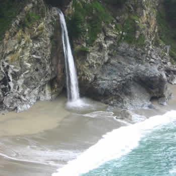 Natural Waterfall Picture: McWay Falls close up photo of famous McWay Falls located in Julia Pfeiffer Burns State Park on the beautiful scenic Pacific Coast Highway 1 just south of Big Sur California; McWay Falls close up photograph.
