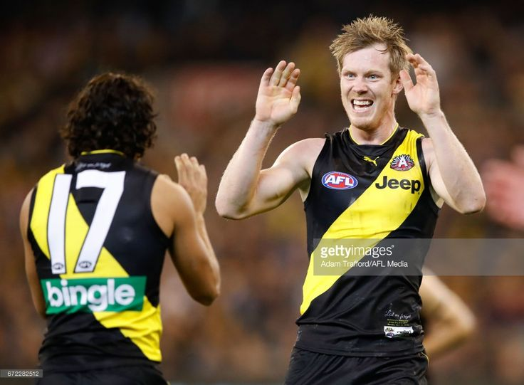 Jack Riewoldt of the Tigers (right) congratulates Daniel Rioli of the Tigers on a goal during the 2017 AFL round 05 match between the Richmond Tigers and the Melbourne Demons at the Melbourne Cricket Ground on April 24, 2017 in Melbourne, Australia.
