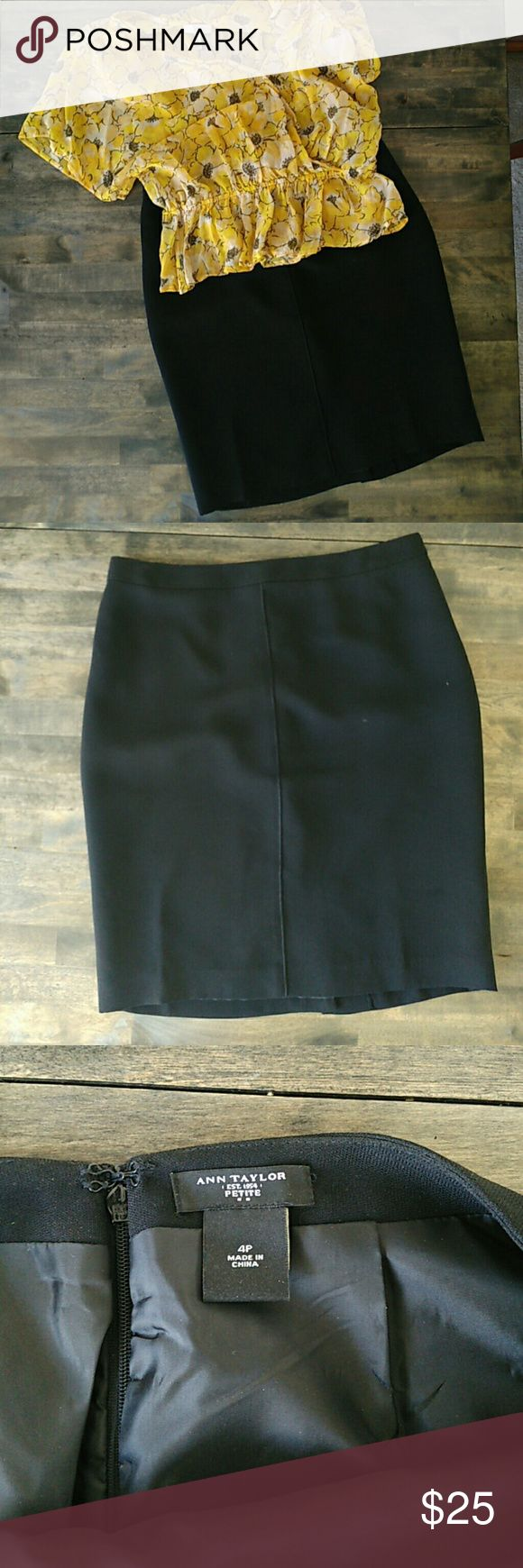 Ann Taylor Petite pencil skirt Black 100% Polyester pencil skirt. Zips in back and has 4 inch slit in back. Skirt is 20.5 inches long, size 4P. Excellent condition. Ann Taylor Skirts Pencil