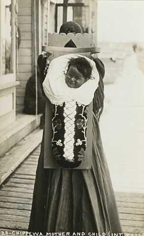 Chippewa mother with child in cradle board, International Falls.  Jerome Studio. Postcard ca. 1910
