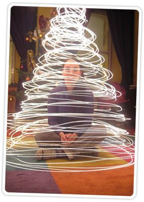 These holiday photos are so creative — painting light with Christmas lights is one unique idea.