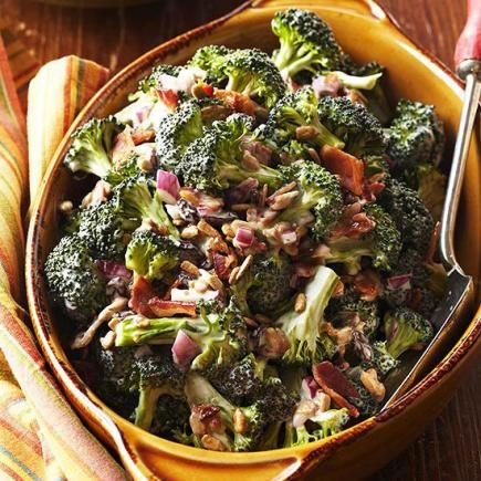 Sunny Broccoli Salad, a potluck classic. Bacon, sunflower kernels and raisins make a crunchy and flavorful side dish.
