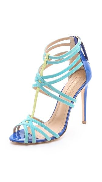 Strappy suede sandals from Aquazzura weave a contrast T-strap through a crisscross vamp. Back zip and covered stiletto heel. Leather sole.