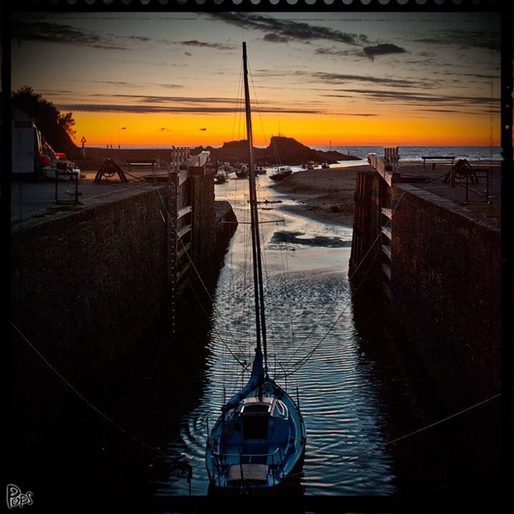 Sunset at Bude sea lock by Pops c/o Love Bude. The sea lock is one of only two in the country. North Cornwall, UK.