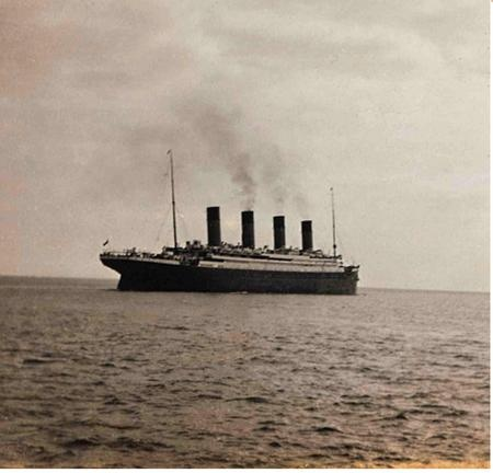 The last photograph of the Titanic afloat as she leaves Queenstown (now Cobh), Ireland.