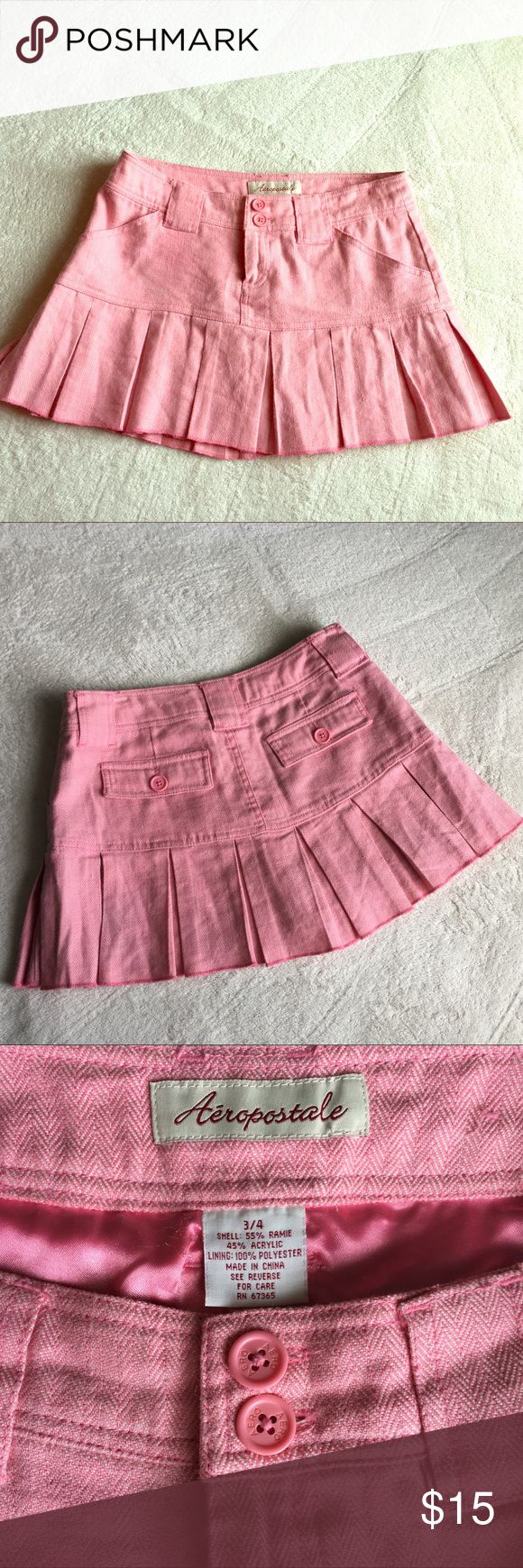 Aeropostale Pleated Miniskirt (UEC) Pink and white herringbone pattern miniskirt. Perfect little cute Summer skirt with a tank top. The versatile material easily translates into an early Autumn ensemble with a little sweater and boots. (I wore it both ways!) Fits true to size and is very comfy. Fabric is 55% Ramie 45% Acrylic (feels like a soft tweed). Inside lining is 100% Polyester (feels like silk). Aeropostale Skirts Mini