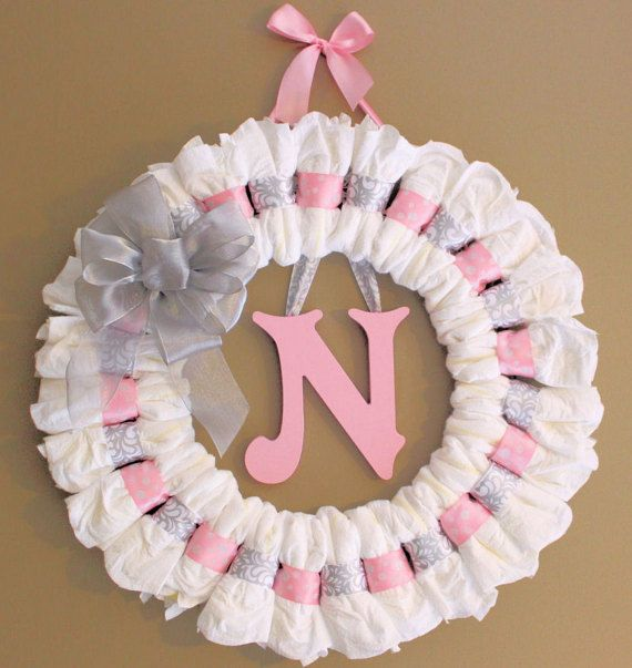 Large Diaper Wreath with your Choice of 8 in. Letter and Font Great Baby Shower Gift or For Welcome Home Gift for Baby  -Size 24 in. x 24 in. wreath size, Hanging ribbon adds about another 5 in. to the top -Includes 27 Pampers Swaddlers Sz 1 Diapers -Includes 8 in. Capital letter. Your choice of Letter, Paint Color and Font(Victorian, Curlz, Times New Roman, Art Script or Arial font) -Whimsical font available in Lowercase letter only. -Letter is tied on to the wreath, so it can be easily…