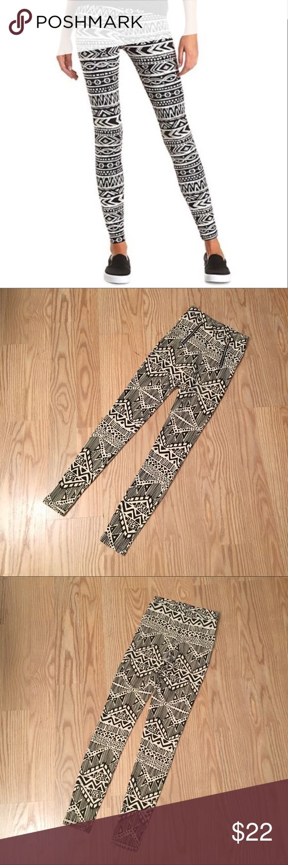 "CHARLOTTE RUSSE Tribal print leggings CHARLOTTE RUSSE black and off white tribal print leggings | gold zippers ok front where pockets would be | mid rise | size S | inseam is 28"" Charlotte Russe Pants Leggings"