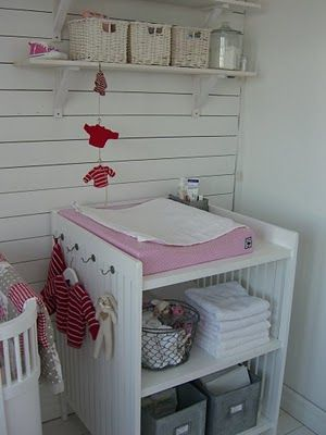 Love this changing table with the hooks on the side!