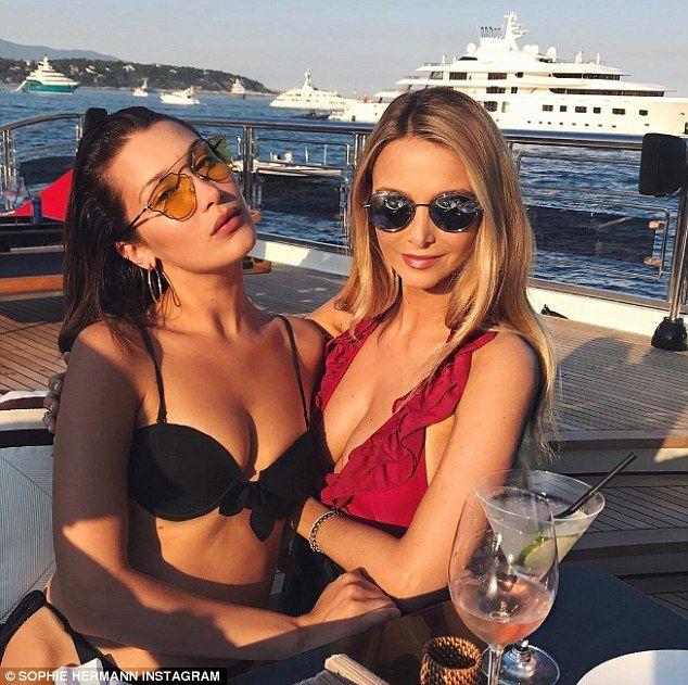 Throwing shade! Bikini-clad Bella Hadid parties on Lewis Hamilton's yacht with fashionista...