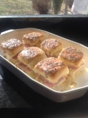 Hawaiian roll ham sandwiches. Try this: Use garlic powder in place of mustard. Spread butter mixture over tops of sandwiches.