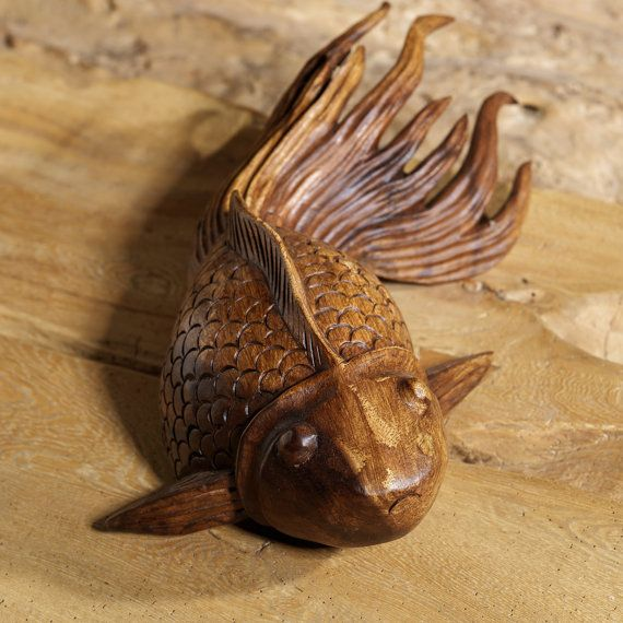 Hand carved goldfish made from suar wood wooden fish