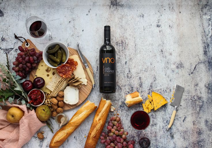 Red wine accompanied by a beautiful selection of cheese and meats for VNO wines