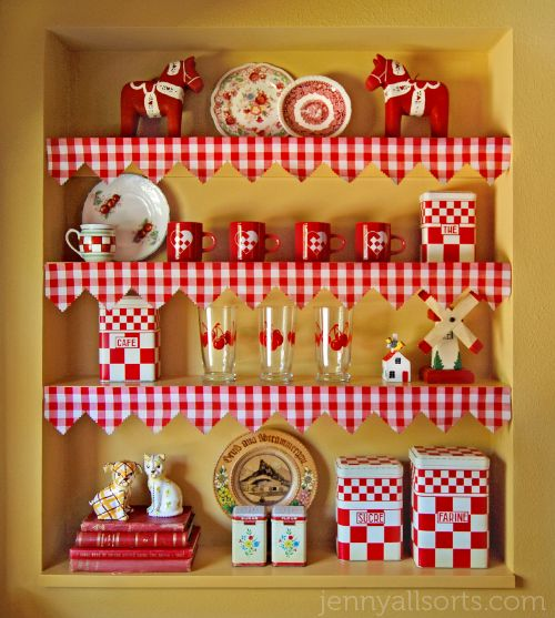 What a great look for shelving...use wallpaper purchased inexpensively on Ebay. Cut to fit shelf, leave three inch overhang & cut out triangles using the checkered pattern as a guide.