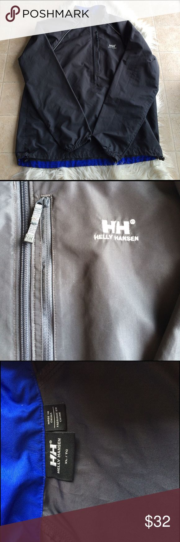 Helly Hansen charcoal gray wind breaker Nice light weight pullover wind breaker by helly Hansen.  Charcoal gray with royal blue accents.  Chest pocket.  Waist can cinch for a tighter fit.  No holes. Used, good condition. Armpit to armpit-24 in.  Shoulder to hem-29 in Helly Hansen Jackets & Coats Windbreakers