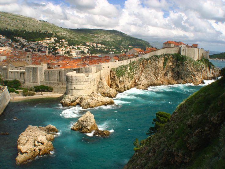 Dubrovnik, Croatia.  The 'Pearl of the Adriatic' although severely damaged by an earthquake in 1667 it managed to preserve its beautiful Gothic, Renaissance and Baroque churches, monasteries, palaces and fountains.  I believe this is also the site of filming for King's Landing for Game of Thrones because the city so resembles that described by George R.R. Martin in a Song of Ice and Fire.