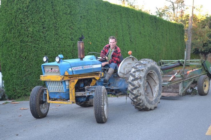 Miles Smart on his tractor headed to his field to pick potatoes