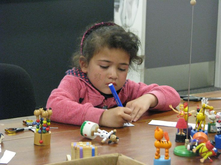 This lovely young girl was enthralled with making her own toys.