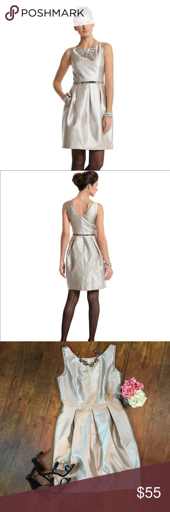 WHBM Gold Tulip Skirt Dress White House Black Market *Belt not included* Celebrate in the shimmer of soft champagne gold. This glamorous cocktail dress channels Holly Golightly sophistication with pockets and a bateau neckline that changes to a drop-V in back. Also shown with the Gold Glitter Bow Skinny Belt, not included. Shell: 87% Polyester, 13% Metallic. Lining: 96% Polyester, 4% Spandex. Dry clean. Imported. White House Black Market Dresses