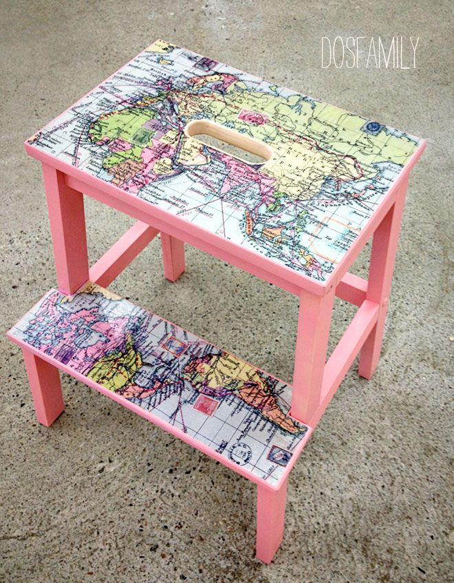 Ikea stool that has been painted pink and decoupaged with a map.