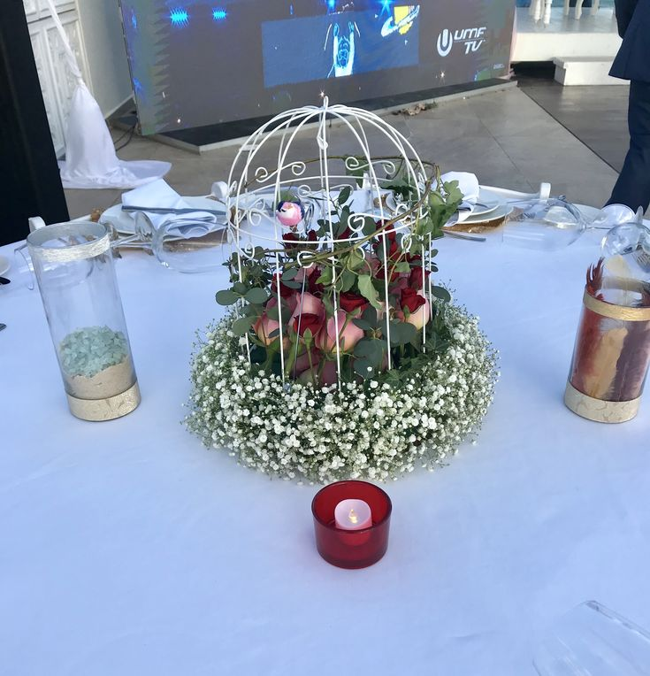 CBC410 wedding Riviera Maya birdcage centerpiece with greenery white, red and pink flowers, baby breath