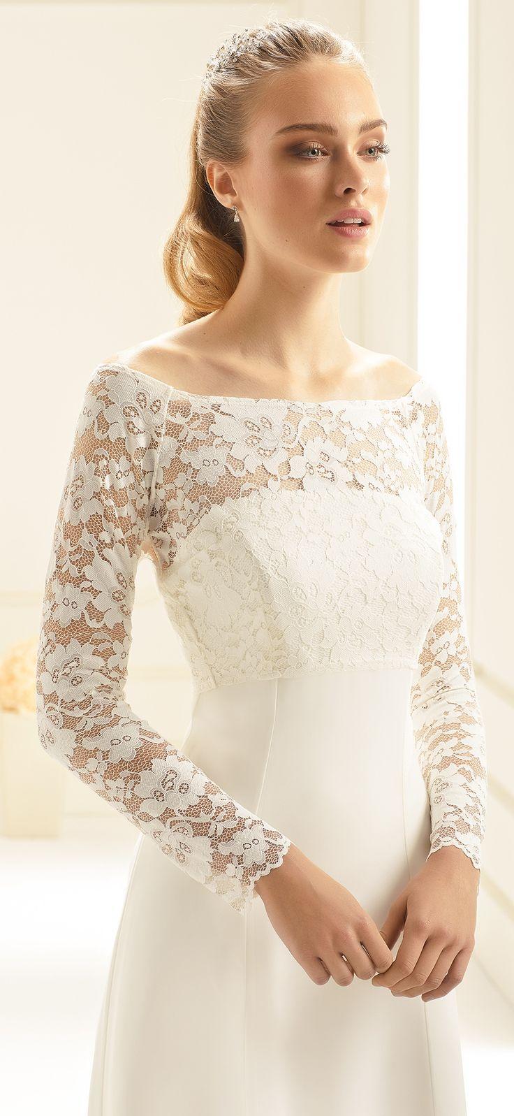 Our bolero E251 made for a winter bride! See more at bianco-evento.com #biancoevento #wedding #weddingdress #bridalwear #bridaccesorries #winterwedding #weddingideas