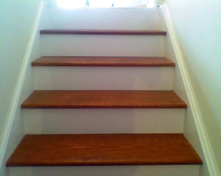 unfinished basement steps:  sanded, stained, sealed and a white backstep added to give them a nice finished look! :) (make sure you start from the bottom and work your way up....almost got stuck in the basement! haha)