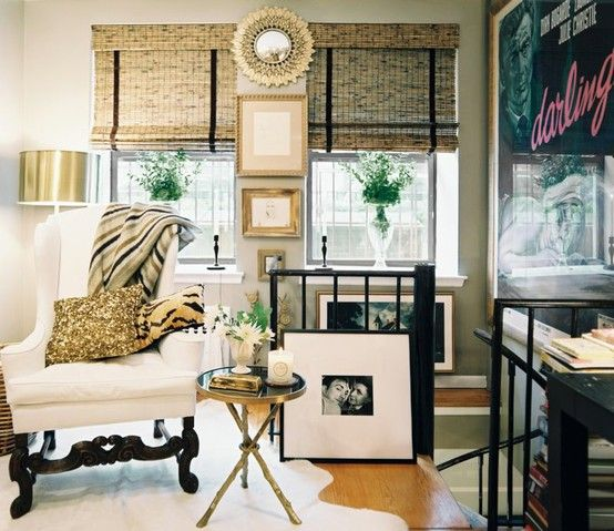 These roman shades are pretty spectacular. Not only is the color of the bamboo so, so pretty and oh-so-natural... but black, velvet ribbon has been adhered to the shades to elongate the windows and add a bit of a graphic flare to the windows.