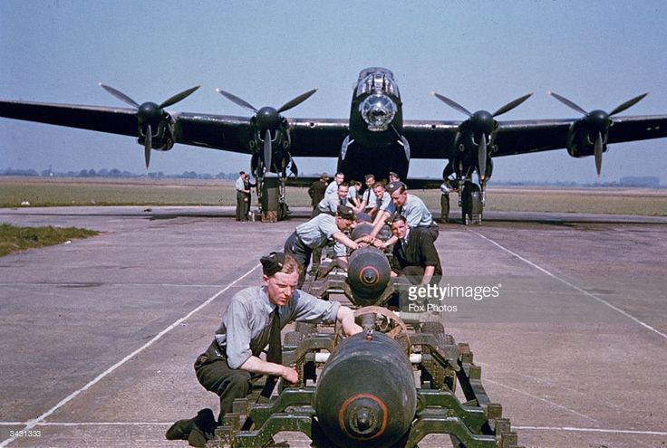 Bombs being loaded onto a RAF  AVRO Lancaster Bomber during World War II.