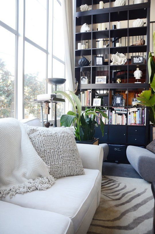 An IKEA Hack of Epic Heights: A Sky-High Stacked Bookcase from KALLAX Shelves