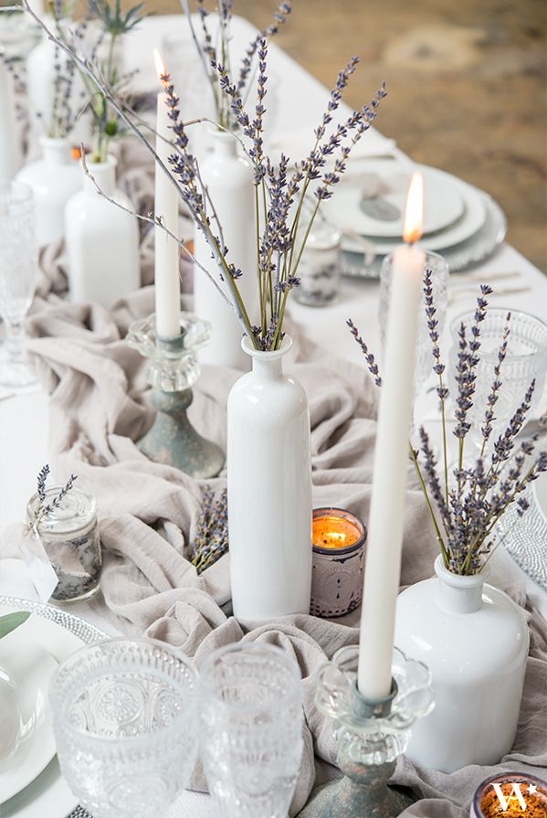 Use white decor and candles with pops of winter florals to dress up your winter wedding reception tables.