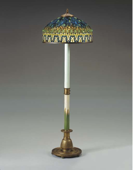 AN UNUSUAL LEADED AND JEWELED GLASS, GILT BRONZE AND FAVRILE GLASS FLOOR LAMP…