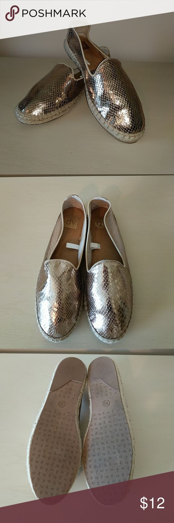 Gold Espadrille Slip-ons Like new condition!  Very trendy slip-on gold espadrille shoes. Tag says size 10, but runs small- would best fit a size 9 or 9.5. DV by Dolce Vita Shoes Espadrilles