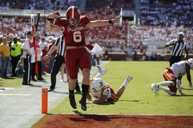 Oklahoma's Baker Mayfield (6) scores a touchdown in front of Joel Lanning (7) during a college football game between the Oklahoma Sooners (OU) and the Iowa State Cyclones at Gaylord Family-Oklahoma Memorial Stadium in Norman, Okla., Saturday, Oct. 7, 2017. Photo by Bryan Terry, The Oklahoman