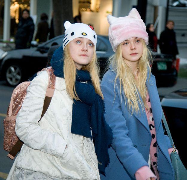 Dakota And Elle Fanning Wore Cat Hats In Korea