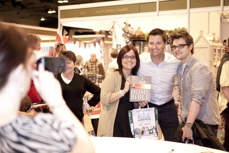 George Clarke having his photo taken with some fans.