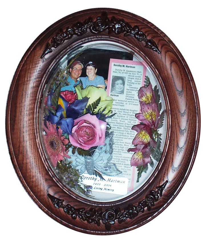 """A beautiful way to celebrate a life well lived. 8 x 10"""" frame. Picture, engraving, obituary, and flowers from the memorial service. $200 inclusive."""
