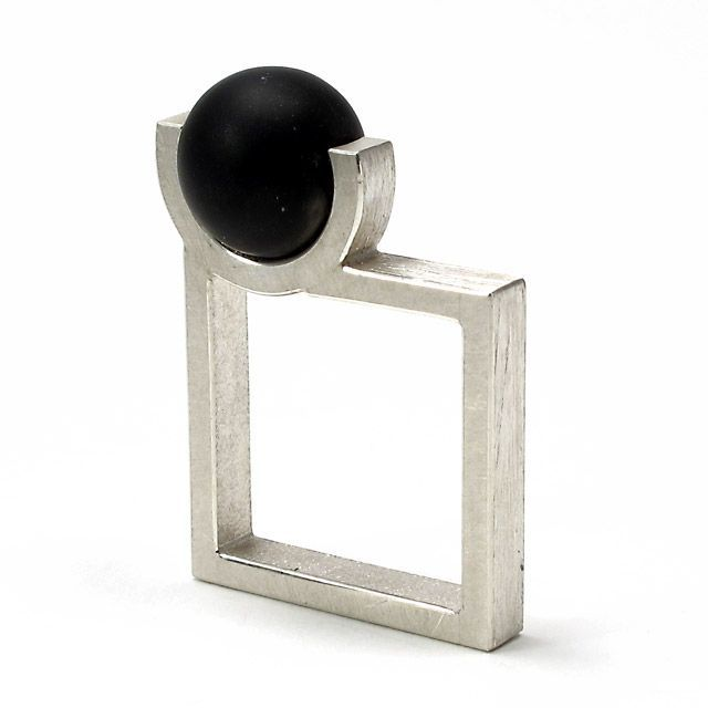 Geoffrey D. Giles square ring in silver and black onyx....