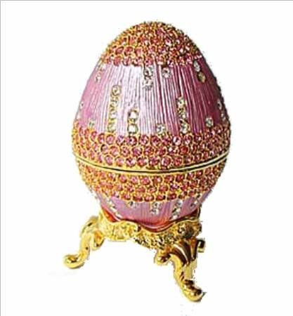 Rose Pink 24K Gold Swarovski Crystals Faberge style Egg Box with Ring Insert Figurine Dazzlers. $49.95. Arrives in a padded, satin lined Presentation Box. 100% Satisfaction Guaranteed by this bonded seller.. Stocked on site! Quick Delivery! (See this item's detailed specifications below.). Certificate of Authenticity included. Limited edition item which is sure to grow in value over time.. Set with sparkling Swarovski Crystals and meticulously hand enameled by s...