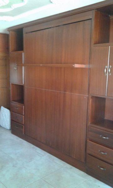 Suministramos  el herraje para la cama abatible  despacho para todo el pais telefonos : 1  5454596  310  8642675  315  3638474 Bogota  Colombia.