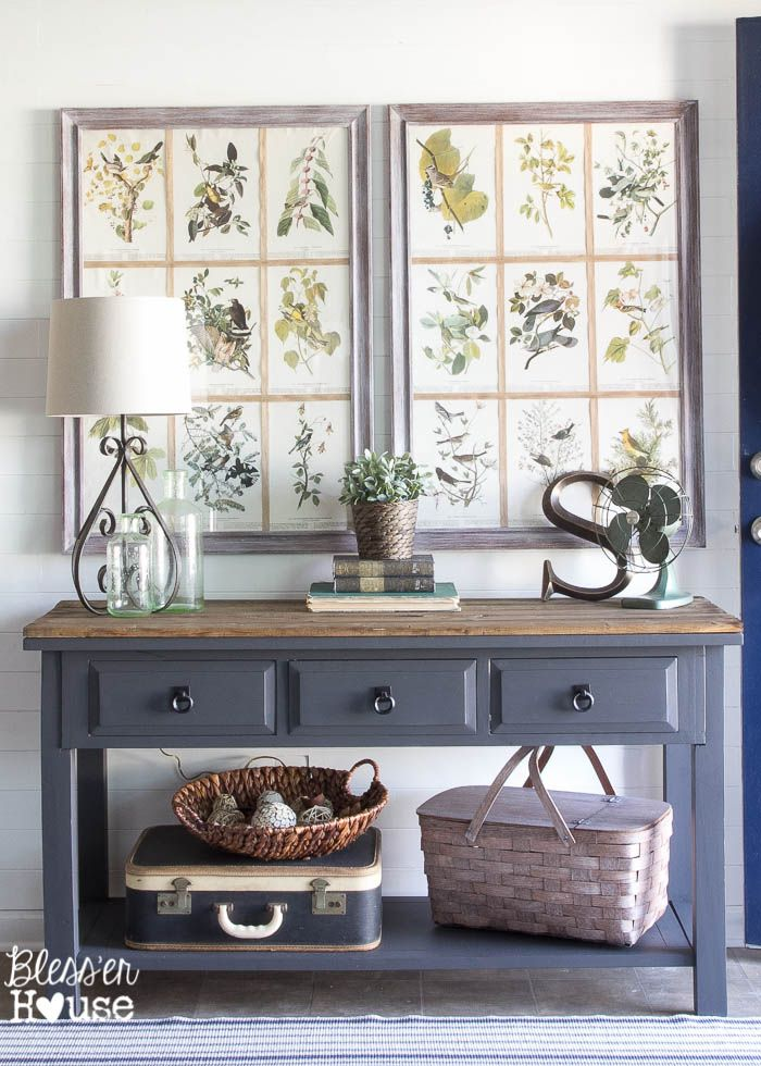 A dark and boring builder grade space gets a modern farmhouse foyer makeover on a major budget.