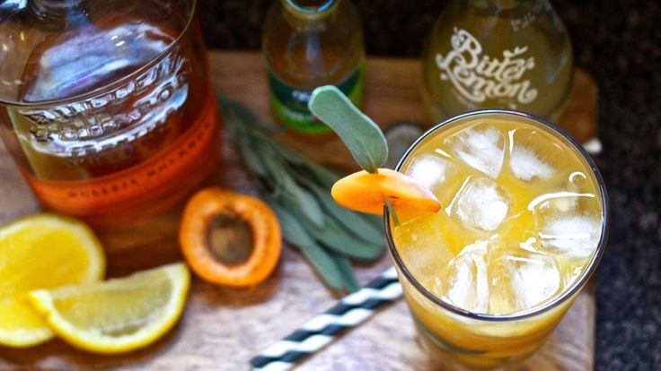 """APRICOT & LEMON MUDDLE: For the gloomy realisation that summer is finally over, the """"Autumn Whisperer"""" cocktail will ease the transition between the two. Mixed with bourbon, apricot nectar, sage leaves, lemon wedges and bitter lemon sparkling water. Recipe on the blog."""