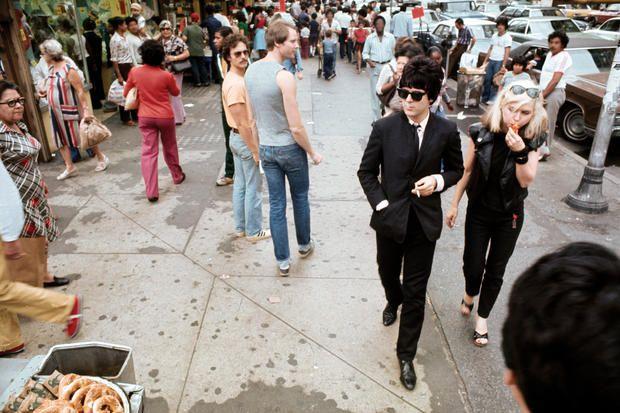 Blondie drummer Clem Burke and Debbie Harry (and various people) in New York, c. 1976.