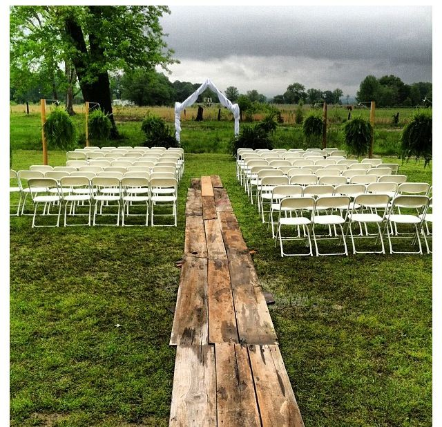 Wedding ceremony for outside wedding! Aisle made of old boards to cover walk way from rain and mud! Simple and elegant! Hanging vintage chandelier.