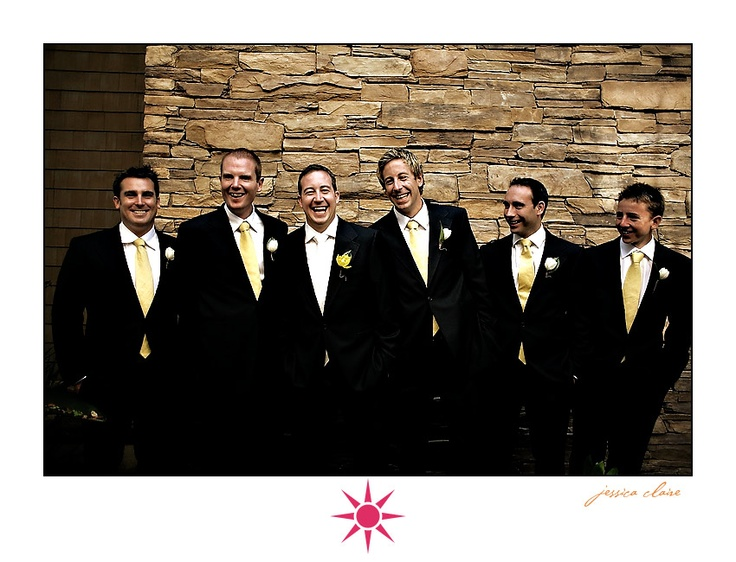 black suit yellow tie white bouts for groomsmen white