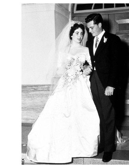 Elizabeth Taylor marries hotel heir Conrad 'Nicky' Hilton in 1950, wearing a gown gifted to her by MGM studios