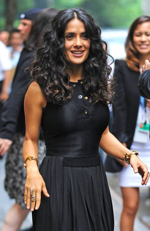 Salma always knows how to keep it classy. The middle part and effortless curls are super natural and great for any occasion.