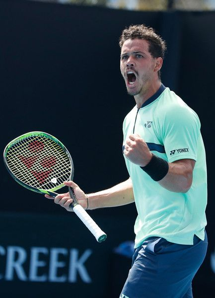 Alex Bolt Photos - Alex Bolt of Australia celebrates winning a point in his first round match against Viktor Troicki of Serbia on day one of the 2018 Australian Open at Melbourne Park on January 15, 2018 in Melbourne, Australia. - 2018 Australian Open - Day 1