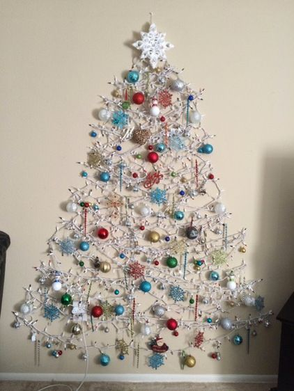 No floor space for a tree. Instead, the apartment dweller made a tree out of lights and ornaments on the wall.